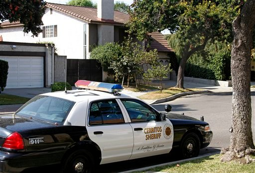 "An unoccupied Los Angeles County Sheriff's Department patrol car is parked across from the home, background, of Nakoula Basseley Nakoula, the man who made the film ""Innocence of Muslims."" (AP Photo/Reed Saxon)"