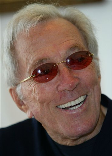 In this July 25, 2004 file photo, U.S. singer Andy Williams smiles as he speaks to reporters during his news conference at a Tokyo hotel. (AP Photo/Shizuo Kambayashi, File)