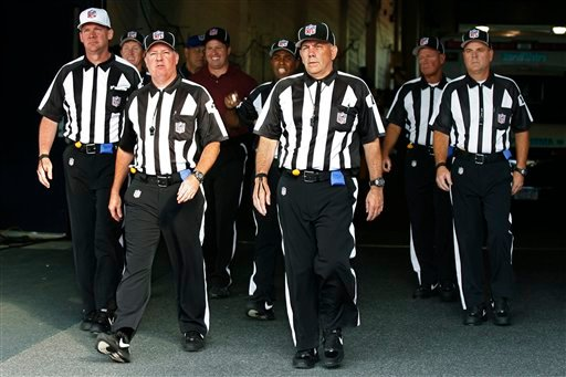 In this Aug. 9, 2012, file photo, officials walk towards the field for an NFL football game between the Buffalo Bills and the Washington Redskins in Orchard Park, N.Y.
