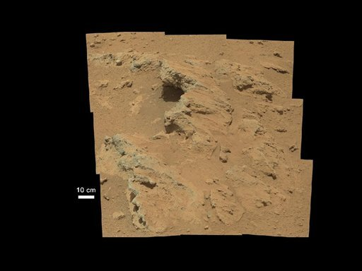 This image provided by NASA shows shows a Martian rock outcrop near the landing site of the rover Curiosity thought to be the site of an ancient streambed. (AP Photo/NASA)