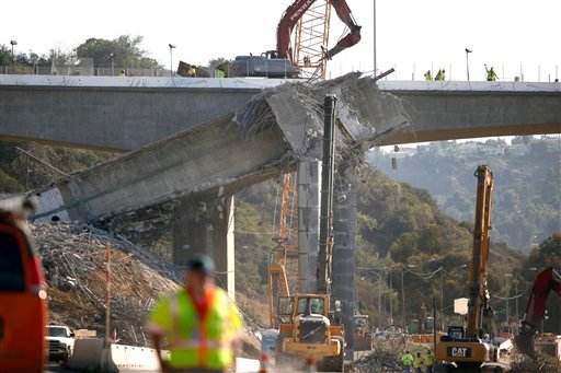 © Workers continue the demolition of the center span of the Mulholland Drive bridge along Interstate 405 in Los Angeles on Saturday Sept. 29,2012.