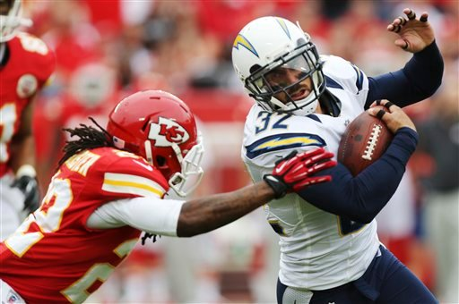 © San Diego Chargers free safety Eric Weddle (32) gets past Kansas City Chiefs wide receiver Dexter McCluster (22) after an interception during the first half of an NFL football game at Arrowhead Stadium in Kansas City, Mo., Sunday, Sept. 30, 2012.
