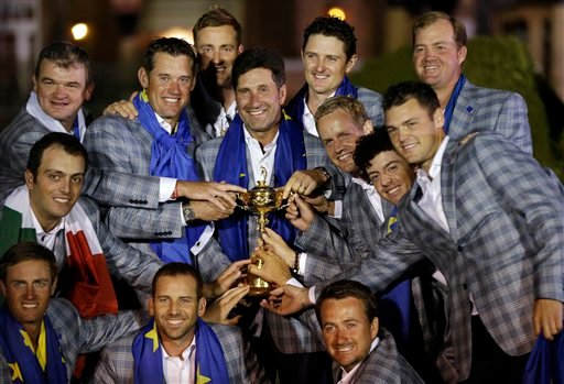 © The European team posses with the trophy after winning the Ryder Cup PGA golf tournament Sunday, Sept. 30, 2012, at the Medinah Country Club in Medinah, Ill. (AP Photo/David J. Phillip)