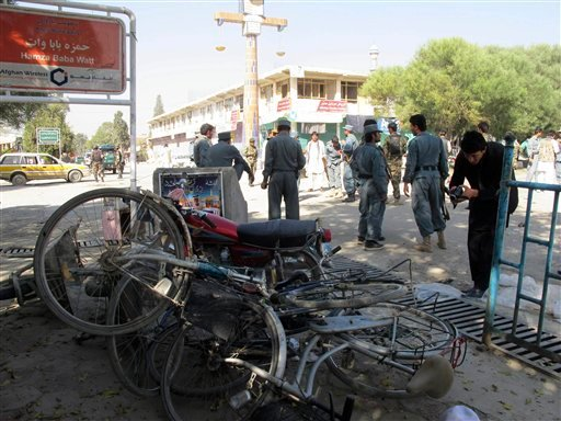 © Afghan police secure the site of a suicide bombing in Khost, south of Kabul, Afghanistan, Monday, Oct. 1, 2012.