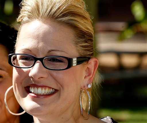 In this June 28, 2012 file photo, Arizona Democratic Rep. candidate, Arizona State Sen. Kyrsten Sinema, is seen at the Arizona Capitol in Phoenix. (AP Photo/Ross D. Franklin, File)