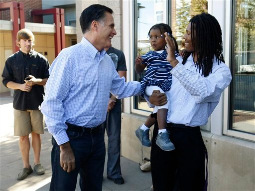 Republican presidential candidate, former Massachusetts Gov. Mitt Romney greets passers-by as he makes an unscheduled stop at a Chipotle restaurant in Denver, Tuesday, Oct. 2, 2012. (AP Photo/Charles Dharapak)