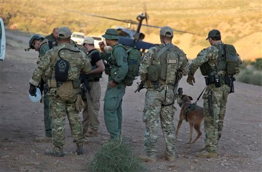 Law enforcement officers gather at a command post in the desert near Naco, Ariz. Oct. 2, 2012, after a Border Patrol agent was shot to death near the U.S.-Mexico line. (AP Photo/U.S. Customs and Border Protection, Gabriel Guerrero)