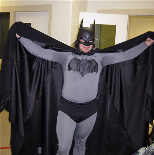 In this May 11, 2011 file photo provided by the Petoskey, Mich., Department of Public Safety shows Mark Williams dressed as Batman, at the Emmet County jail in Petoskey, Mich. Michigan State Police arrested Williams, 33, in his Batman outfit.