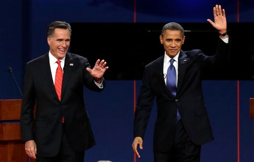 Republican presidential nominee Mitt Romney and President Barack Obama wave to the audience during the first presidential debate at the University of Denver, Wednesday, Oct. 3, 2012, in Denver.