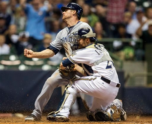 San Diego Padres' Chase Headley beats the tag at home from Milwaukee Brewers' Jonathan Lucroy during the seventh inning of a baseball game, Wednesday, Oct. 3, 2012, in Milwaukee. (AP Photo/Tom Lynn)