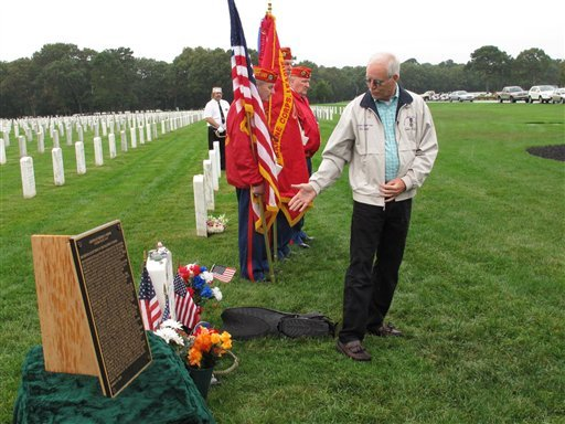 Daniel Murphy, the father of Navy SEAL Lt. Michael Murphy, notes some of the tributes left at the gravesite of his son at Calverton National Cemetery on Tuesday, Oct. 2, 2012.