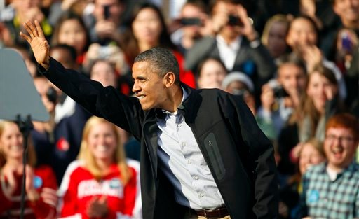 President Barack Obama waves to waves to supporters after a campaign speech Thursday, Oct. 4, 2012, at the University of Wisconsin-Madison in Madison, Wis. (AP Photo/Andy Manis)