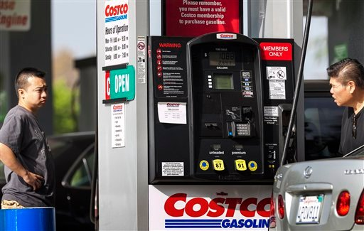 Motorists refuel at the Costco gas station in Burbank, Calif., Friday, Oct. 5, 2012. (AP Photo/Damian Dovarganes)