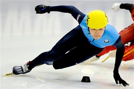 © In this Feb. 20, 2011, file photo, winner Simon Cho, of the United States, competes during the men's 500-meter final race at the Short Track Speedskating World Cup in Dresden, Germany.
