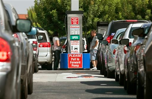 © Costco members fill up with discounted gasoline at a Costco gas station in Van Nuys, Calif., Friday, Oct. 5, 2012.