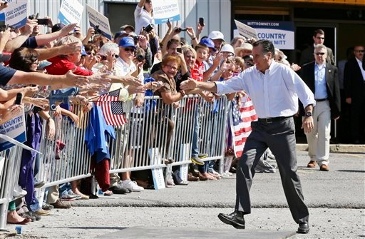 © Republican presidential candidate, former Massachusetts Gov. Mitt Romney campaigns at Carter Machinery in Abingdon, Va., Friday, Oct. 5, 2012. (AP Photo/Charles Dharapak)