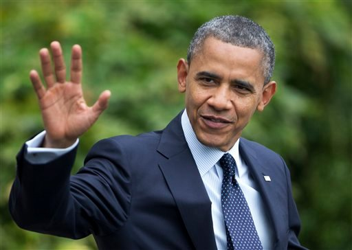 © President Barack Obama waves as he leaves the White House in Washington for a campaign trip to Los Angeles, Calif., Sunday, Oct. 7, 2012.