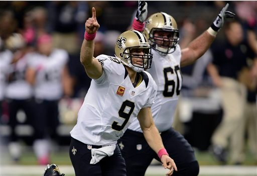 New Orleans Saints quarterback Drew Brees (9) reacts after completing a touchdown pass for his 48th consecutive game, breaking Johnny Unitas' NFL record which stood for over 50 years.