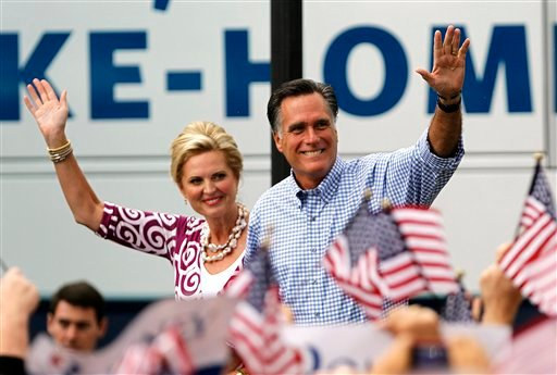 © Republican presidential candidate and former Massachusetts Gov. Mitt Romney, right, waves as he arrives with his wife Ann at a campaign rally, Sunday, Oct. 7, 2012, in Port St. Lucie, Fla.