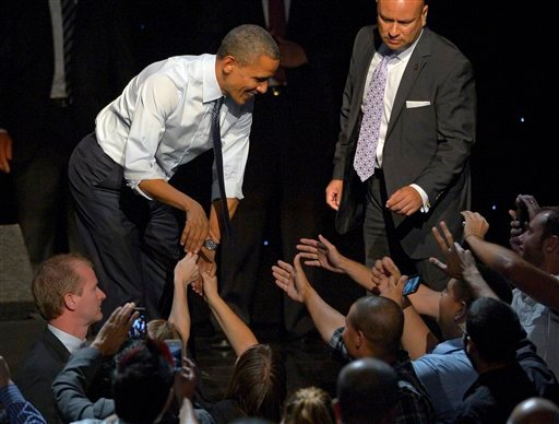© President Barack Obama shakes hands with supporters at a campaign event at the Nokia Theater, Sunday, Oct. 7, 2012, in Los Angeles.