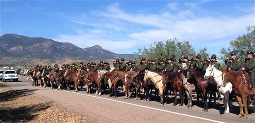 Mounted officers line the route during the funeral procession for slain U.S. Border Patrol agent Nicholas Ivie on Oct. 8, 2012 at the Church of Jesus Christ of Latter Day Saints in Sierra Vista, AZ. (AP Photo/Brian Skoloff)