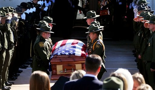 U.S. Border Patrol agents lift the casket holding slain agent Nicholas Ivie during the funeral at The Church of Jesus Christ of Latter Day Saints in Sierra Vista, Ariz., on Monday, Oct. 8, 2012. (AP Photo/Arizona Daily Star,Mike Christy)