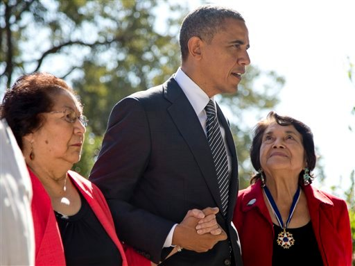 President Obama walks with Cesar Chavez' widow Helen F. Chavez, left, and Dolores Huerta, Co-Founder of the United Farm Workers, as they tour the Cesar E. Chavez National Monument Memorial Garden Oct. 8, 2012 in Keene, Calif. (AP Photo/Carolyn Kaster)