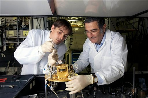 © This 2009 photo provided Tuesday Oct. 9, 2012 by the CNRS (Centre Nationale de la Recherche Scientifique) shows French physician Serge Haroche, right, and his aide Igor Dotsenko in Paris.