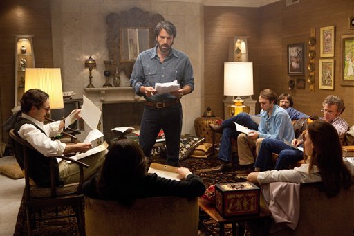 "© This film image released by Warner Bros. Pictures shows Ben Affleck as Tony Mendez, center, in ""Argo,"" a rescue thriller about the 1979 Iranian hostage crisis."
