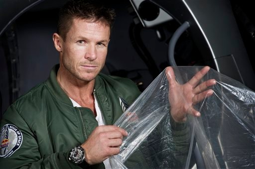 © In this Feb. 23, 2012 photo provided by Red Bull Stratos, pilot Felix Buamgartner of Austria shows a piece of the balloon material during the Red Bull Stratos egress training in Lancaster, Calif.