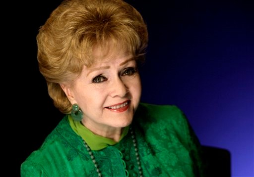 FILE - This Oct. 14, 2011 file photo shows actress Debbie Reynolds posing for a portrait in New York. (AP Photo/Richard Drew, file)