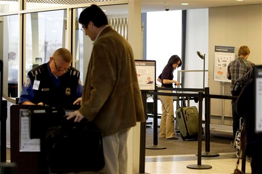 In this Nov. 17, 2011 photo, travelers move through the security area of Newark Liberty International Airport in Newark, N.J.  (AP Photo/Julio Cortez, File)