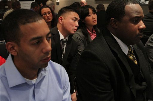 In this Friday Sept. 28, 2012, photo, a group of veterans listen during a session with one of the employers at a job fair introducing veterans to careers in the security and private investigations industry at Yankee Stadium in New York. (AP Photo)