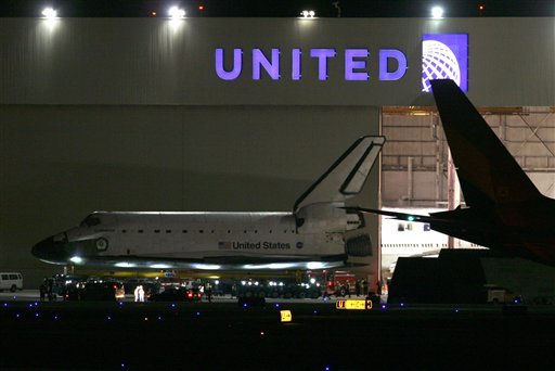 © The space shuttle Endeavour is moved out of the United hangar at Los Angeles International Airport just before midnight Thursday, Oct. 11, 2012 to begin its two-day trek across Los Angeles and Inglewood to the California Science Center.