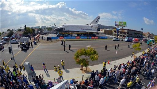 Spectators gather to watch the space shuttle Endeavour in Los Angeles, Friday, Oct. 12, 2012. (AP Photo/Mark J. Terrill)