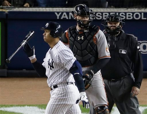 New York Yankees' Alex Rodriguez, left, reacts after striking out with two runners on base in the eighth inning of Game 4 of the American League division baseball series. (AP Photo/Peter Morgan)