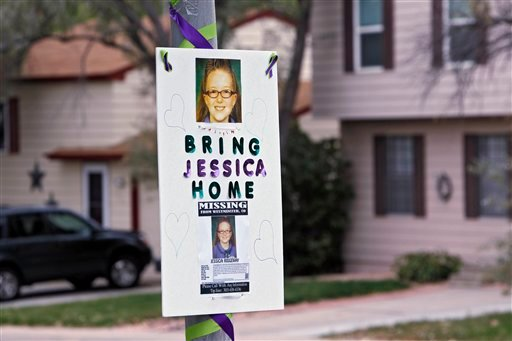 A missing person sign is posted on a lamp post near the home of ten-year-old Jessica Ridgeway where police continue to search for the missing girl in Westminster, Colo., on Wednesday, Oct. 10, 2012. (AP Photo/Ed Andrieski)