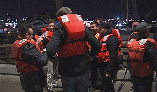 © This image provided by KTVU-TV shows some of the 22 rescued passengers on the pier Friday Oct.12, 2012 in San Francisco.