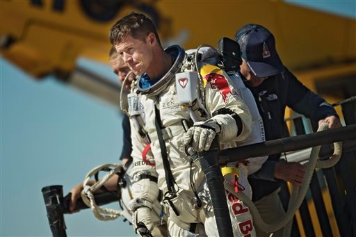 © This photo provided by Red Bull Stratos shows pilot Felix Baumgartner of Austria reacting after his mission was aborted in Roswell, N.M., Tuesday, Oct. 9, 2012.