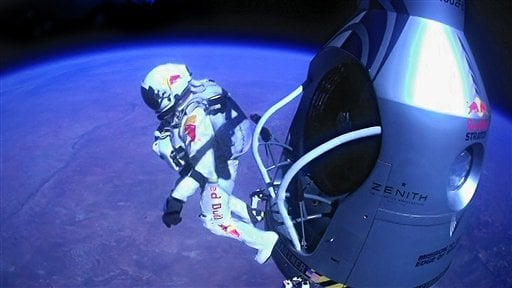 © This image provided by Red Bull Stratos shows pilot Felix Baumgartner of Austria as he jumps out of the capsule during the final manned flight for Red Bull Stratos on Sunday, Oct. 14, 2012.