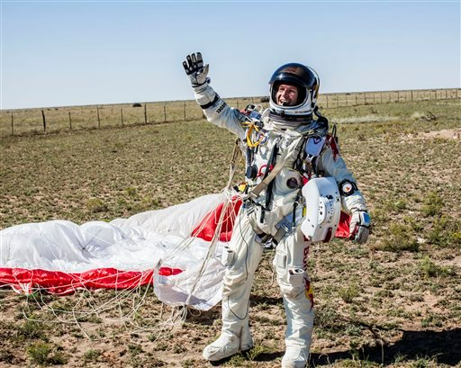 © In this photo provided by Red Bull Stratos, Pilot Felix Baumgartner of Austria celebrates after successfully completing the final manned flight for Red Bull Stratos in Roswell, N.M.