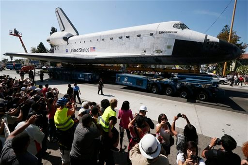 © The space shuttle Endeavour is moved to the California Science Center in Los Angeles on Saturday, Oct. 13, 2012. (AP Photo/Lucy Nicholson, Pool)