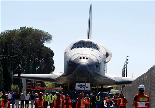 © In thousands of Earth orbits, the space shuttle Endeavour traveled 123 million miles. But the last few miles of its final journey are proving hard to get through.