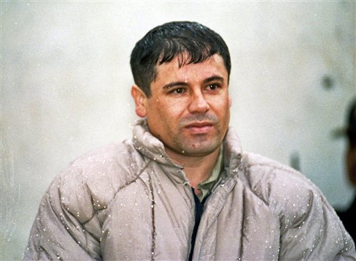 """© Joaquin """"El Chapo"""" Guzman, leader of Mexico's Sinaloa cartel, appears for reporters after his arrest at the high security prison of Almoloya de Juarez on the outskirts of Mexico City, from which he later escaped."""