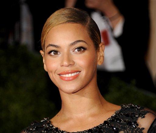 This May 7, 2012 file photo shows Beyonce Knowles at the Metropolitan Museum of Art Costume Institute gala benefit, celebrating Elsa Schiaparelli and Miuccia Prada in New York. (AP Photo/Evan Agostini, file)