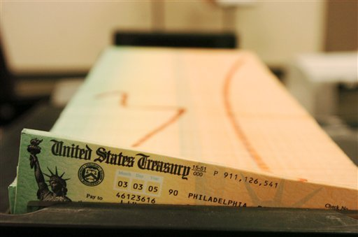 This Feb. 2005 file photo shows trays of printed social security checks, in Philadelphia, waiting to be mailed from the U.S. Treasury. (AP Photo/Bradley C. Bower, File)