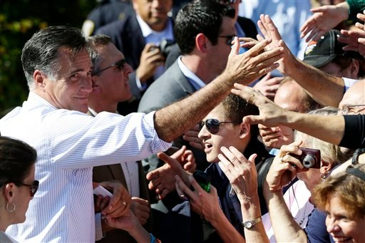 Republican presidential candidate, former Massachusetts Gov. Mitt Romney greets supporters during a campaign stop at Tidewater Community College in Chesapeake, Va., Wednesday, Oct. 17, 2012. (AP Photo/Charles Dharapak)