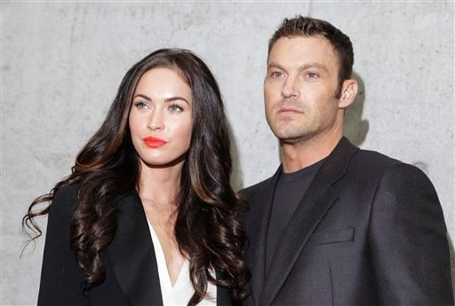 FILE - This Sept. 25, 2010 file photo shows American actress Megan Fox posing with her husband Brian Austin Green after watching the presentation of the Emporio Armani Spring-Summer 2011 fashion collection, during the fashion week in Milan, Italy. (AP)