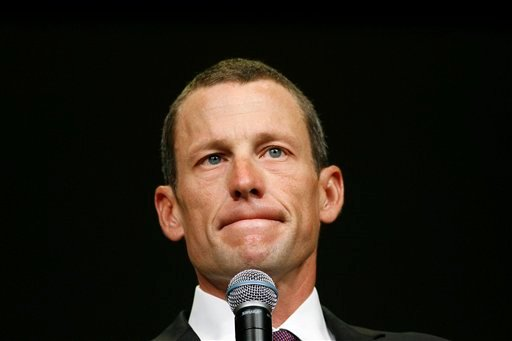 FILE - This Aug. 24, 2009 file photo shows Lance Armstrong during the opening session of the Livestrong Global Cancer Summit in Dublin, Ireland. (AP Photo/Peter Morrison, File)