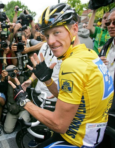In this July 24, 2005 file photo, Lance Armstrong wears a Nike logo on his jersey prior to the start of the 21st and final stage of the Tour de france cycling race, between Corbeil-Essonnes, south of Paris, and the French capital. (AP Photo/Peter Dejong